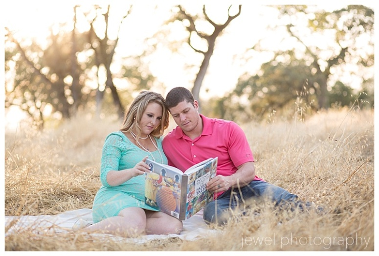 maternity couple reading baby book